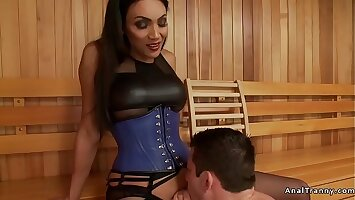 Shemale gives facial to male in sauna